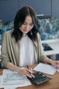 woman figuring taxes